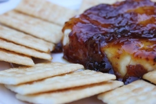 baked brie block in preserves and garlic